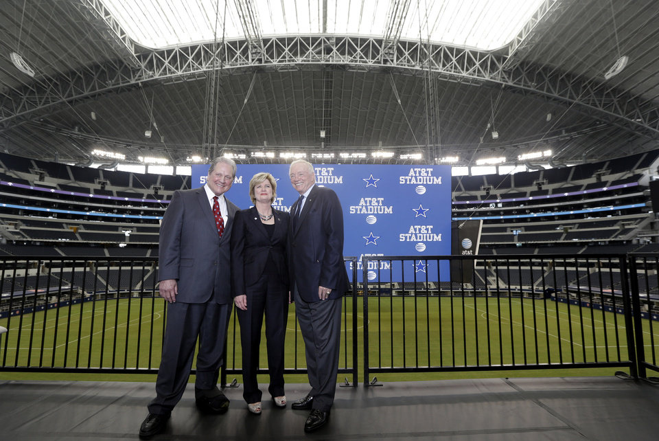 Photo - Dallas Cowboys owner Jerry Jones, right, AT&T senior vice president Cathy Coughlin, center, and Arlington Mayor Robert Cluck  pose for photos after a news conference announcing the naming of the new AT&T Stadium and home of the Dallas Cowboys Thursday, July 25, 2013, in Arlington, Texas. The terms of the naming deal were not released.  (AP Photo/LM Otero)