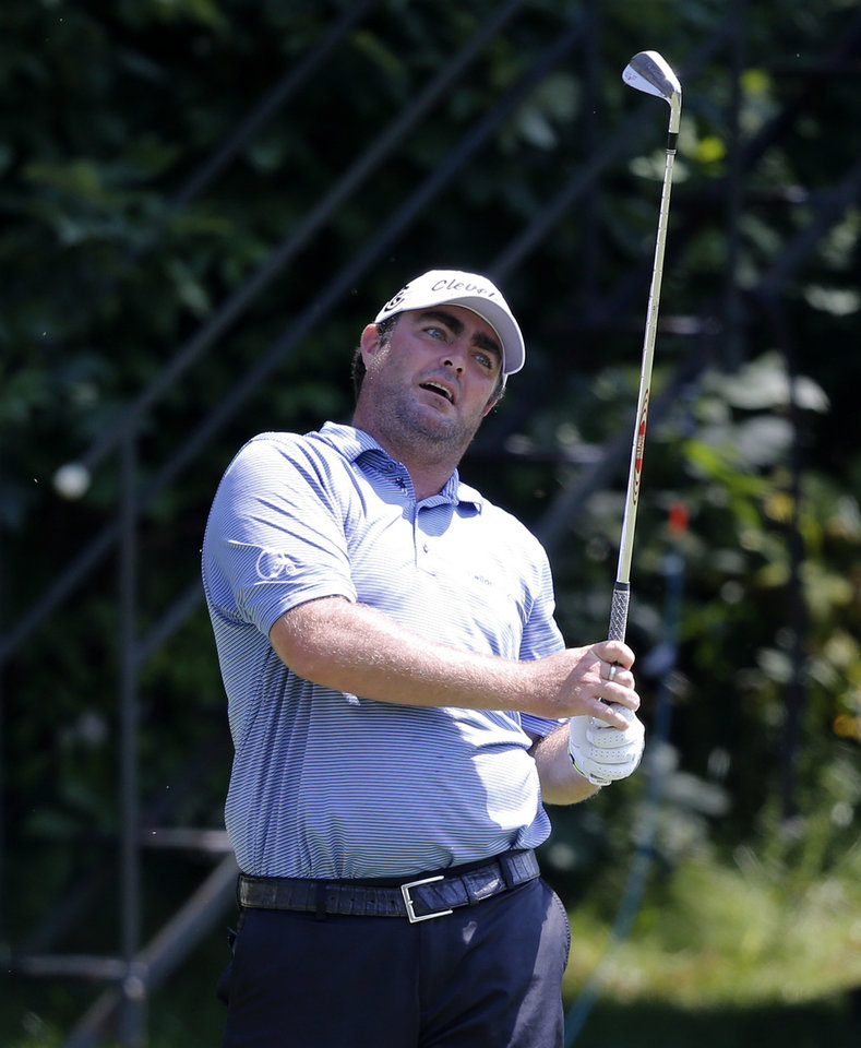 Photo - Steven Bowditch, from Australia, watches his tee shot on the 16th hole during the first round of the 2014 John Deere Classic golf tournament at TPC Deere Run in Silvis, Ill., Thursday, July 10 2014. (AP Photo/Charles Rex Arbogast)