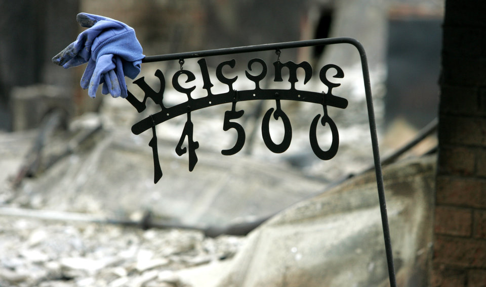 Photo - This welcome sign is about all that stands at this home on NE 4th street that was destroyed in a wildfire in Choctaw, Oklahoma April 10, 2009.  Photo by Steve Gooch, The Oklahoman