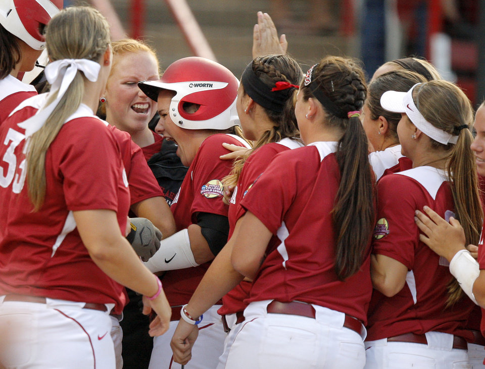 Oklahoma\'s Georgia Casey celebrates with teammates after she hit a home run against California in the sixth inning of their Women\'s College World Series game at ASA Hall of Fame Stadium in Oklahoma City, Friday, June 1, 2012. Photo by Bryan Terry, The Oklahoman