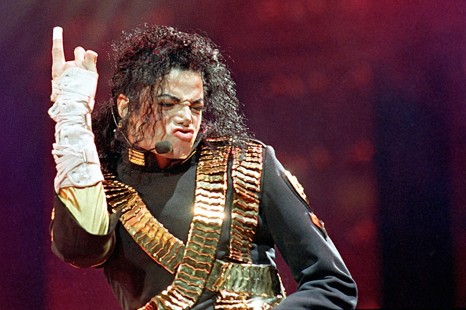 "FILE - In this Aug. 25, 1993 file photo, American pop star Michael Jackson performs during his ""Dangerous"" tour in Bangkok. (AP Photo/Jeff Widerner, file) ORG XMIT: NYET718"