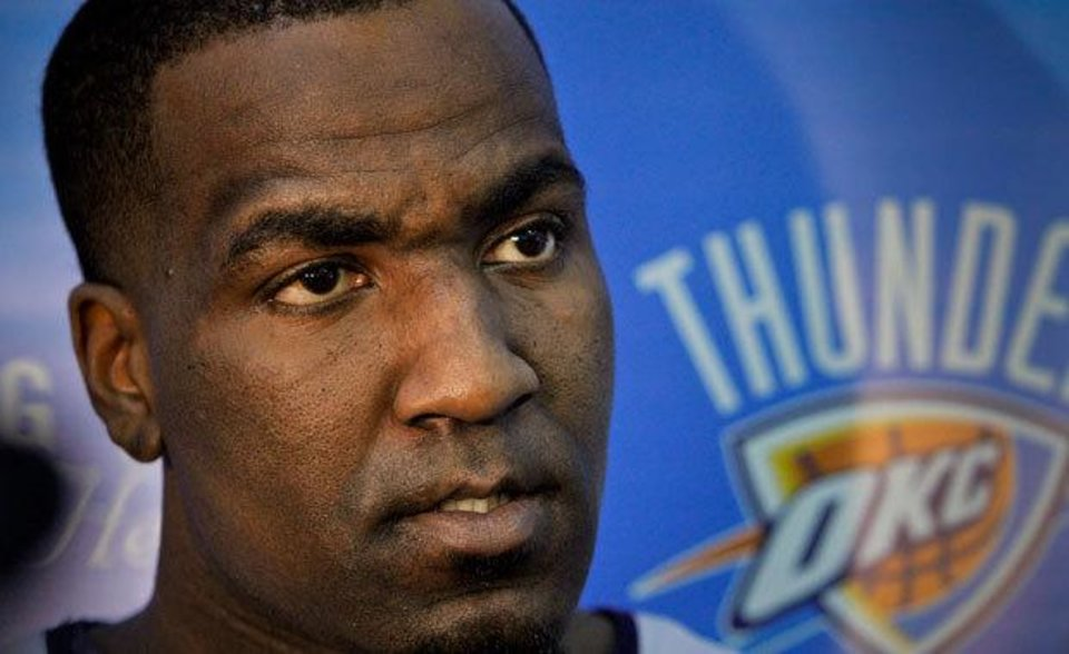 Photo - Oklahoma City's Kendrick Perkins (5) talks to the media during Oklahoma City Thunder practice on Monday, April 18, 2011, in Oklahoma City, Okla. Photo by Chris Landsberger, The Oklahoman