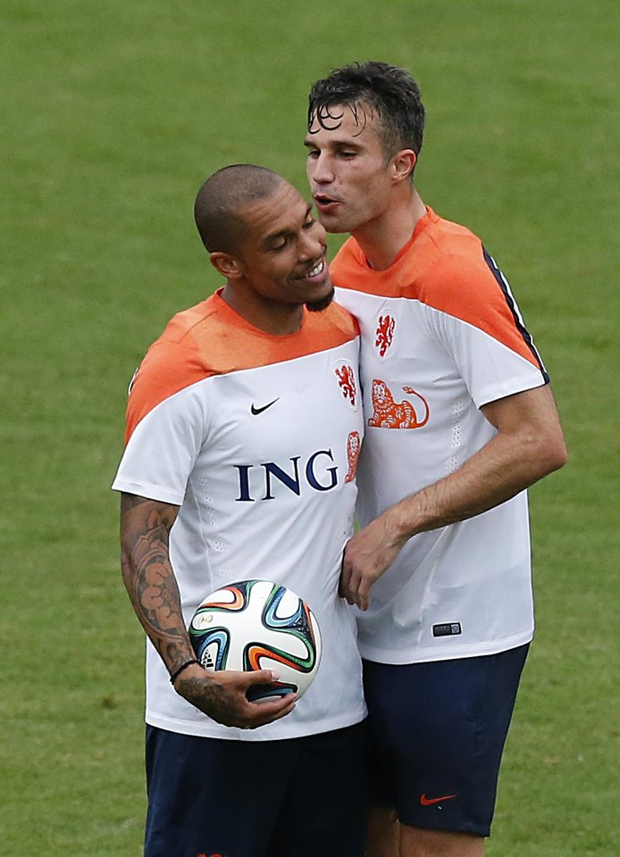 Photo - Robin van Persie, right, and Nigel de Jong, left, of the Netherlands share a light moment during a training session in Rio de Janeiro, Brazil, Tuesday, June 10, 2014.  The Netherlands play in group B of the 2014 soccer World Cup. (AP Photo/Wong Maye-E)