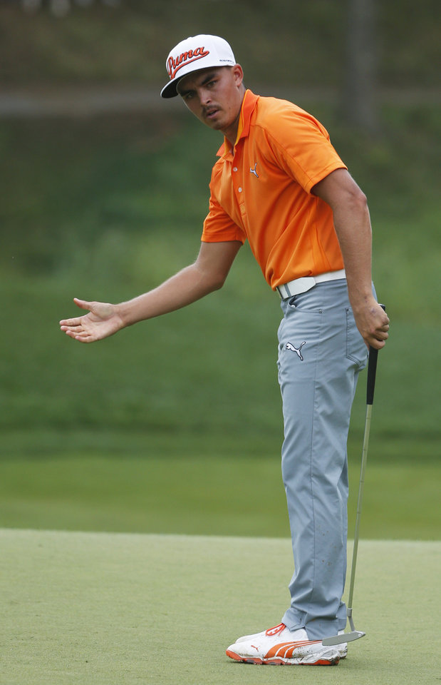 Photo - Rickie Fowler misses his birdie putt on the eighth hole during the final round of the PGA Championship golf tournament at Valhalla Golf Club on Sunday, Aug. 10, 2014, in Louisville, Ky. (AP Photo/Mike Groll)
