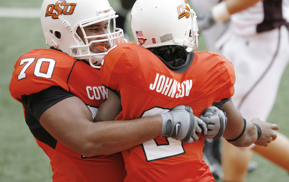 Photo - Jonathon Rush gives Beau Johnson a bear hug after a TD at the Oklahoma State University (OSU) football game against Missouri State University (MSU) Saturday Sept. 13, 2008 at Boone Pickens Stadium in Stillwater, Okla. BY MATT STRASEN, THE OKLAHOMAN.