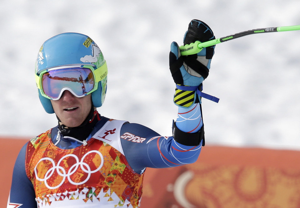 Photo - United States' Ted Ligety waves from the finish area after completing the first run of the men's giant slalom at the Sochi 2014 Winter Olympics, Wednesday, Feb. 19, 2014, in Krasnaya Polyana, Russia. (AP Photo/Gero Breloer)