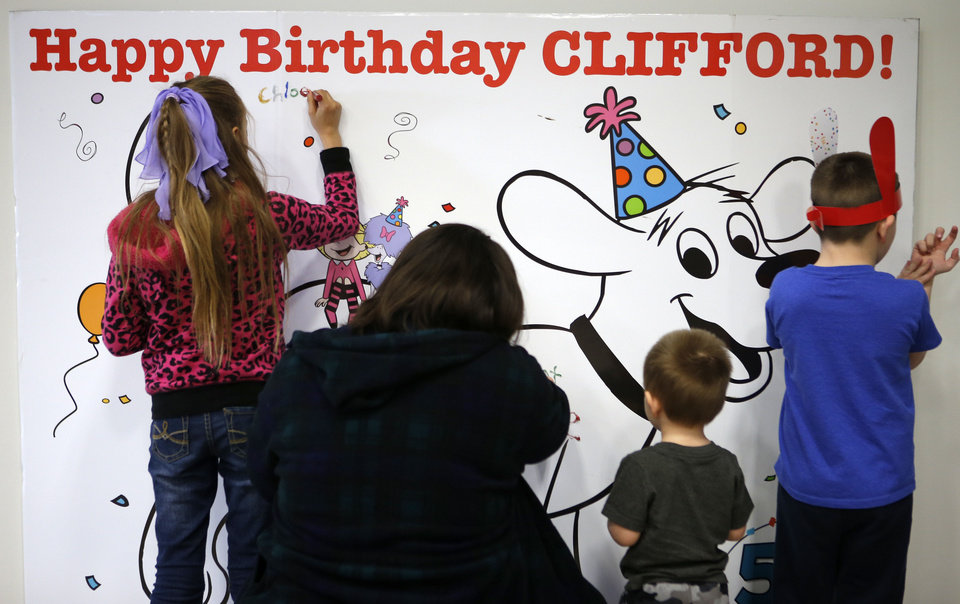 Children sign s card during a birthday party for Clifford the Big Red Dog in Moore, Okla., Saturday, Feb. 16, 2013. Photo by Bryan Terry, The Oklahoman