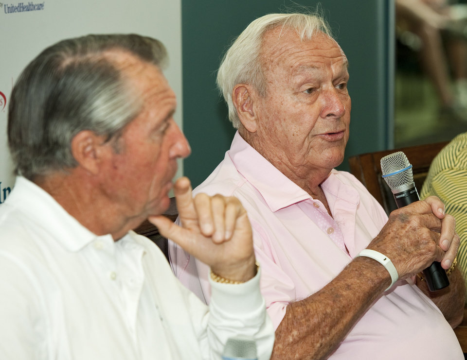 Golfers Arnold Palmer, right, comments during a news conference with Gary Player, left, before a Greats of Golf event Saturday, May 5, 2012, in The Woodlands, Texas. (AP Photo/Dave Einsel)