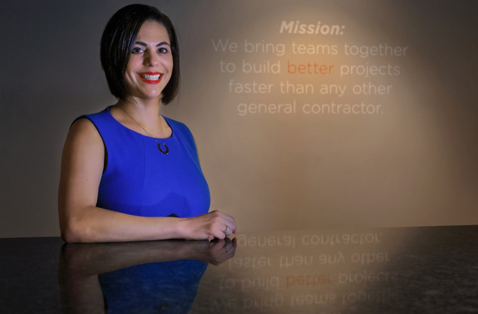 Photo -  Deemah Ramadan, managing partner of DBG Construction LLC, poses for a photo at her office at 1301 Cornell Parkway. [PHOTO BY CHRIS LANDSBERGER, THE OKLAHOMAN]