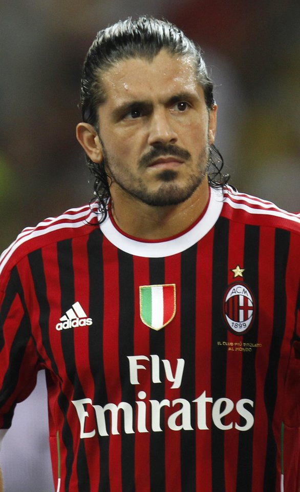 Photo - In this photo taken on Sunday, Aug. 21, 2011, AC Milan midfielder Gennaro Gattuso waits for the start of a friendly soccer match betweeen AC Milan and Juventus  at the San Siro stadium in Milan, Italy. Former AC Milan and Italy standout Gennaro Gattuso has been placed under investigation for match-fixing and four more people have been arrested in an early morning police sweep in Italy. Cremona prosecutor Roberto Di Martino, who has been leading the Last Bet operation for three years, confirmed to The Associated Press Tuesday, Dec. 17, 2013 that Gattuso and retired Lazio player Cristian Brocchi allegedly were part of a ring that fixed Serie A and other Italian matches at the end of the 2010-11 season. More than 50 people have been arrested in Italy for match-fixing since mid-2011, with matches under investigation by prosecutors in Cremona, Bari and Naples. (AP Photo/Luca Bruno)