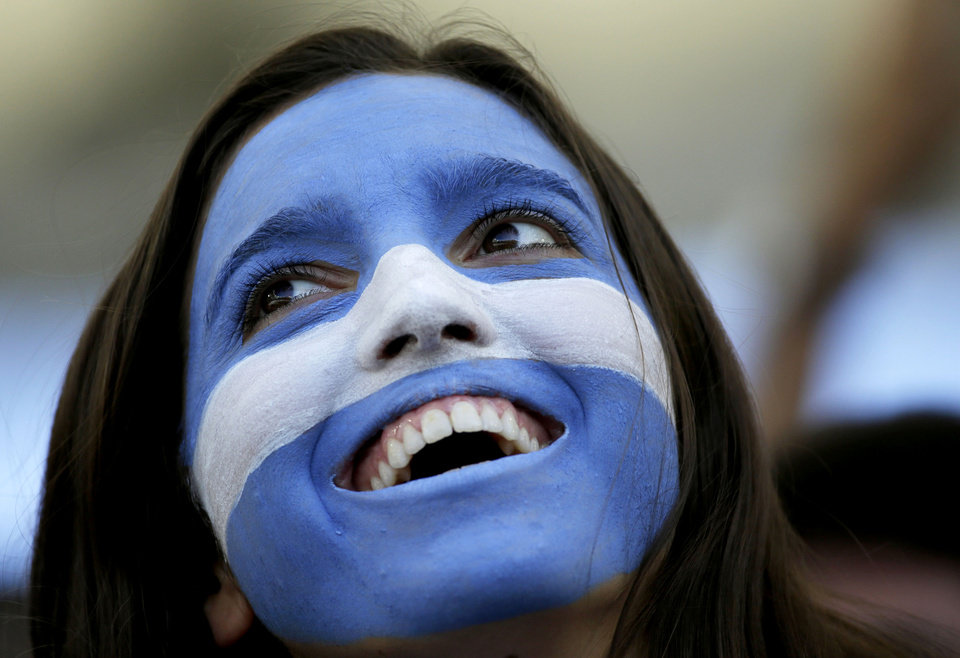 Photo - An Argentine supporter waits for the start of the World Cup final soccer match between Germany and Argentina at the Maracana Stadium in Rio de Janeiro, Brazil, Sunday, July 13, 2014. (AP Photo/Felipe Dana)