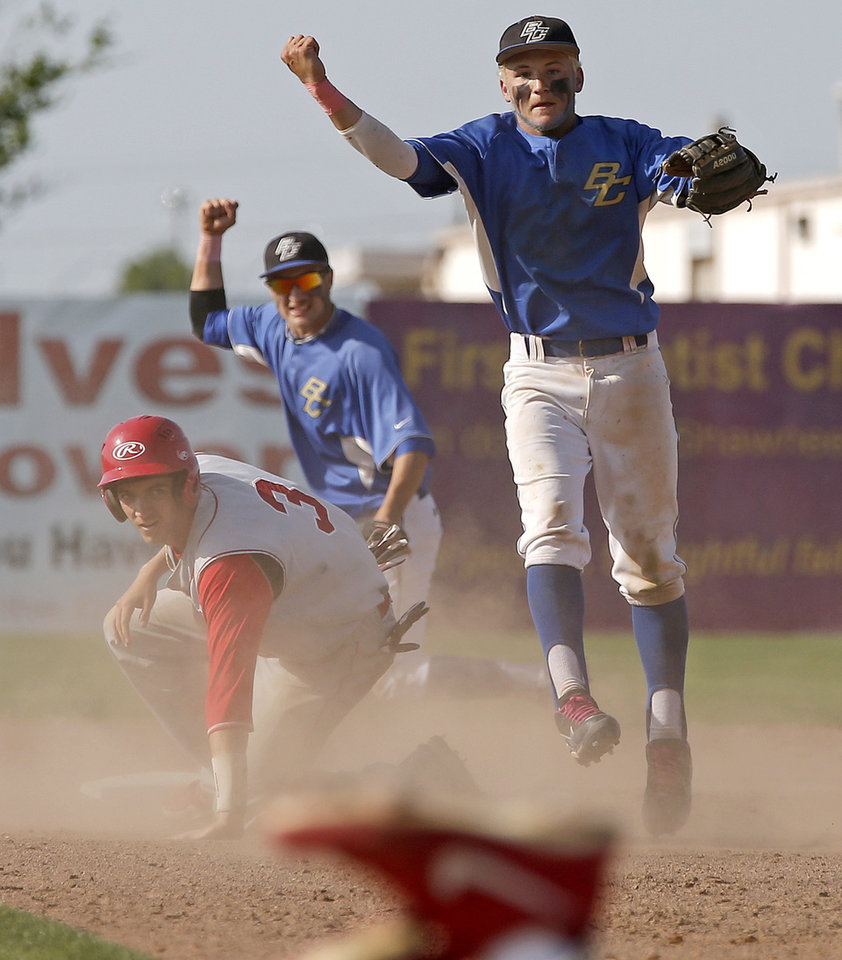 Berryhill's Christian Davidson, at right, reacts after throwing back to first for a double play as Plainview's Kyle Williams watches in the seventh inning of the Class 4A state baseball tournament championship game in Shawnee, Okla., Saturday, May 11, 2013. Photo by Bryan Terry, The Oklahoman
