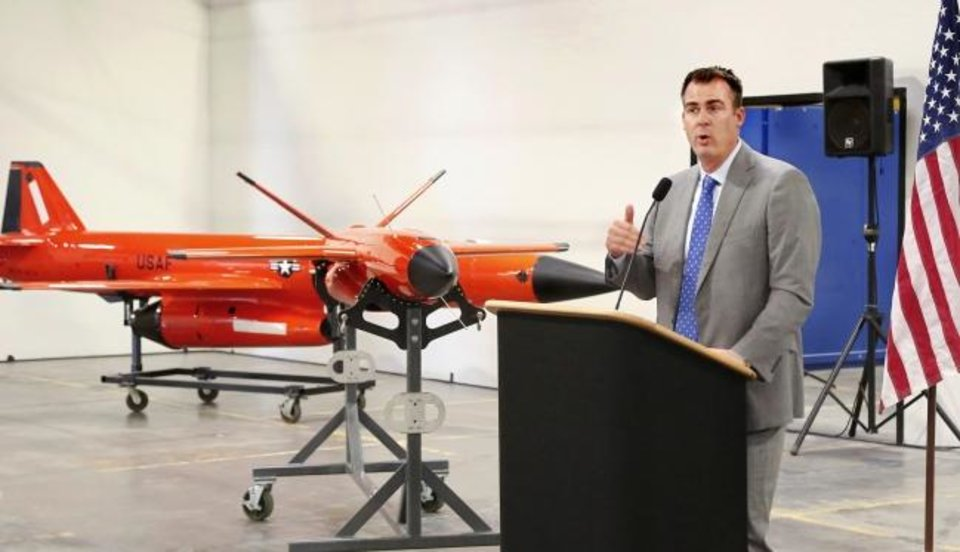 Photo -  Gov. Kevin Stitt speaks Wednesday at a reception at the Kratos Defense manufacturing facility. [JIM BECKEL/THE OKLAHOMAN]