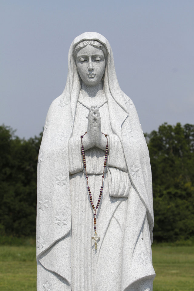 Photo - A new statue of Our Lady of Guadalupe has been erected in the Our Lady of Guadalupe Garden at Sunny Lane Cemetery in Del City.  Steve Gooch - The Oklahoman