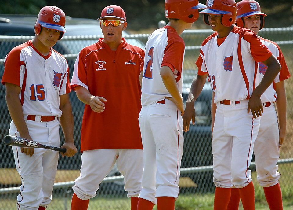 Photo - Former Major League Baseball player and current head coach of the Binger-Oney High School baseball team Reggie Willits talks with his team during the game on Thursday, Sept. 20, 2012, in Binger, Okla. Photo by Chris Landsberger, The Oklahoman