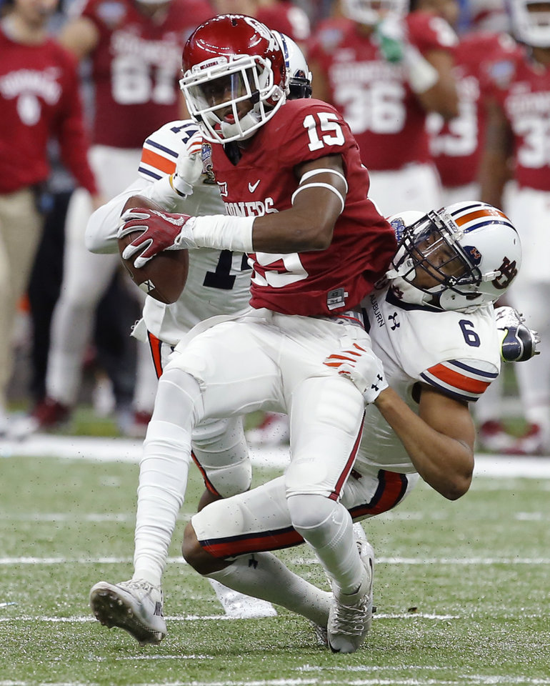 Photo - Oklahoma's Jeffery Mead (15) is brought down by Auburn's Carlton Davis (6) during the Allstate Sugar Bowl between the University of Oklahoma Sooners (OU) and the Auburn University Tigers at the Mercedes-Benz Superdome in New Orleans, Monday, Jan. 2, 2017.  Photo by Bryan Terry, The Oklahoman