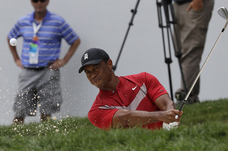 Photo -  Tiger Woods hits from a bunker on the 13th hole during the final round of the BMW Championship golf tournament at Medinah Country Club, Sunday, Aug. 18, 2019, in Medinah, Ill. (AP Photo/Nam Y. Huh)