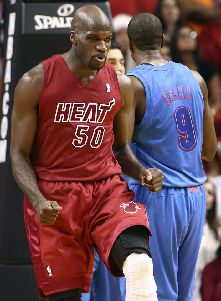 Miami Heat's Joel Anthony (50) reacts after scoring against the Oklahoma City Thunder during the second half of an NBA basketball game in Miami, Tuesday, Dec. 25, 2012. The Heat won 103-97. (AP Photo/J Pat Carter) ORG XMIT: FLJC120