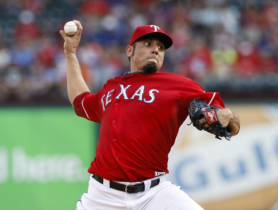 Photo - Texas Rangers starting pitcher Matt Garza throws to the Los Angeles Angels during the first inning of a baseball game, Monday, July 29, 2013, in Arlington, Texas. (AP Photo/Jim Cowsert)