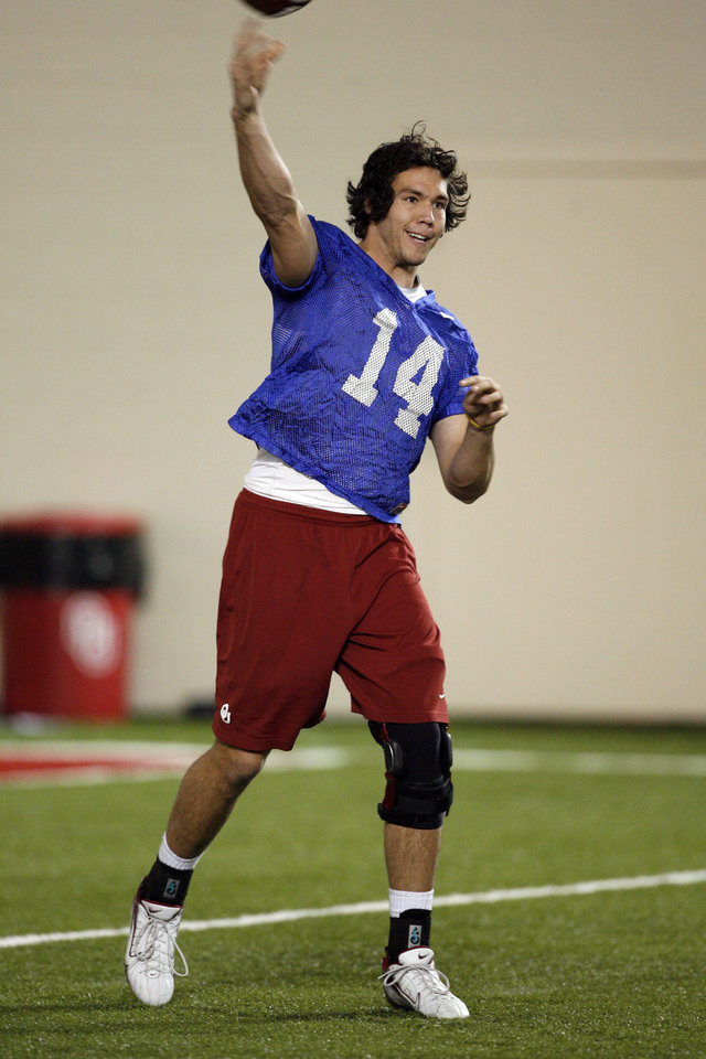 Photo - Quarterback Sam Bradford (14) at the University of Oklahoma (OU) spring football practice in Norman, Oklahoma, on Tuesday, March 3, 2009.   