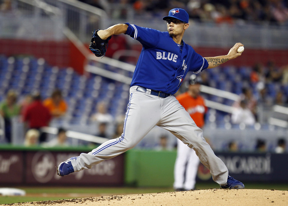 Photo -   Toronto Blue Jays starter Brett Cecil throws to the Miami Marlins during the second inning of a baseball game in Miami, Saturday, June 23, 2012. (AP Photo/J Pat Carter)