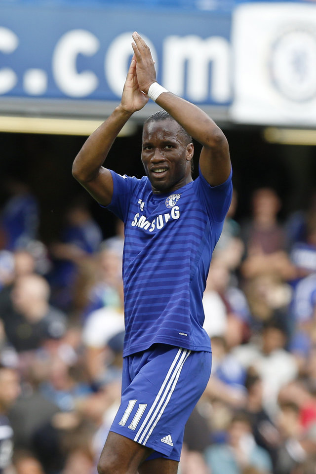 Photo - Chelsea's Didier Drogba applauds the fans at the end of their English Premier League soccer match against Leicester City at Stamford Bridge, London, Saturday, Aug. 23, 2014. (AP Photo/Sang Tan)