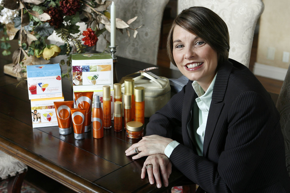 Photo - ARBONNE INTERNATIONAL: Ann Forrester, an executive national vice president for Arbonne, shows some of her company's product at her home in Edmond, Okla., Thursday, September 6, 2007. Photo by Paul Hellstern / The Oklahoman. ORG XMIT: KOD ORG XMIT: OKC0709061334348469