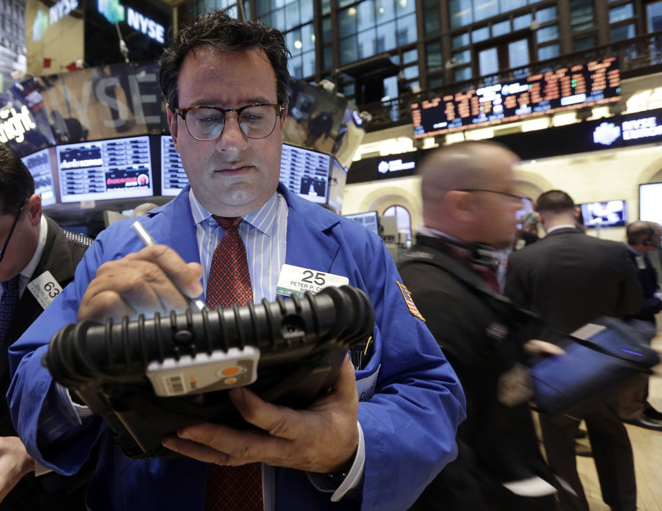 Photo - FILE - In this Feb. 8, 2013 file photo. Trader Peter Costa, left, works on the floor of the New York Stock Exchange, in New York. Stock markets in Hong Kong, mainland China and Seoul were among those closed Monday, Feb. 11, 2013, for the Lunar New Year holiday. Japanese markets were also shut for a public holiday. European stocks were mostly higher in early trading, while Wall Street futures signaled gains ahead of the opening bell. (AP Photo/Richard Drew, File)