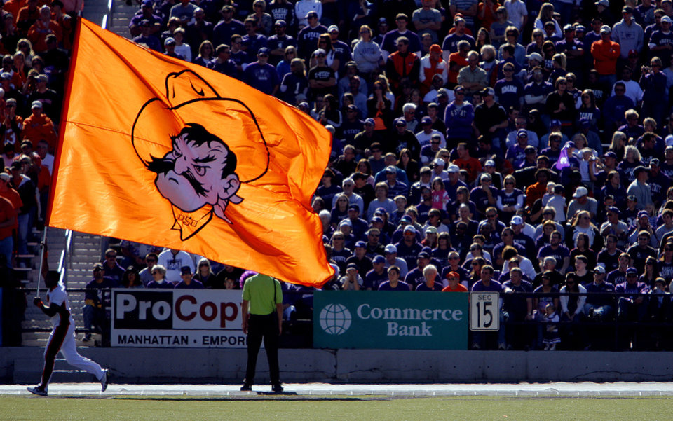 Photo - The Oklahoma State Cowboy's flag waves in front of the Kansas State fans after a Cowboy's touchdown during the first half of the college football game between the Oklahoma State University Cowboys (OSU) and the Kansas State University Wildcats (KSU) on Saturday, Oct. 30, 2010, in Manhattan, Kan.   Photo by Chris Landsberger, The Oklahoman