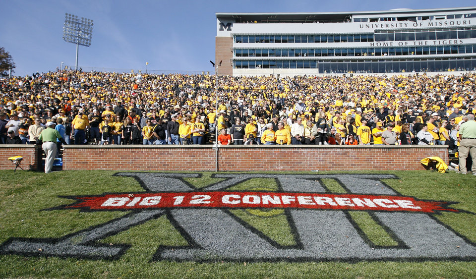 Photo - Missouri fans wait for the beginning of the college football game between the Oklahoma State University Cowboys (OSU) and the University of Missouri Tigers (Mizzou) at Faurot Field in Columbia, Mo., Saturday, Oct. 22, 2011. Photo by Sarah Phipps, The Oklahoman