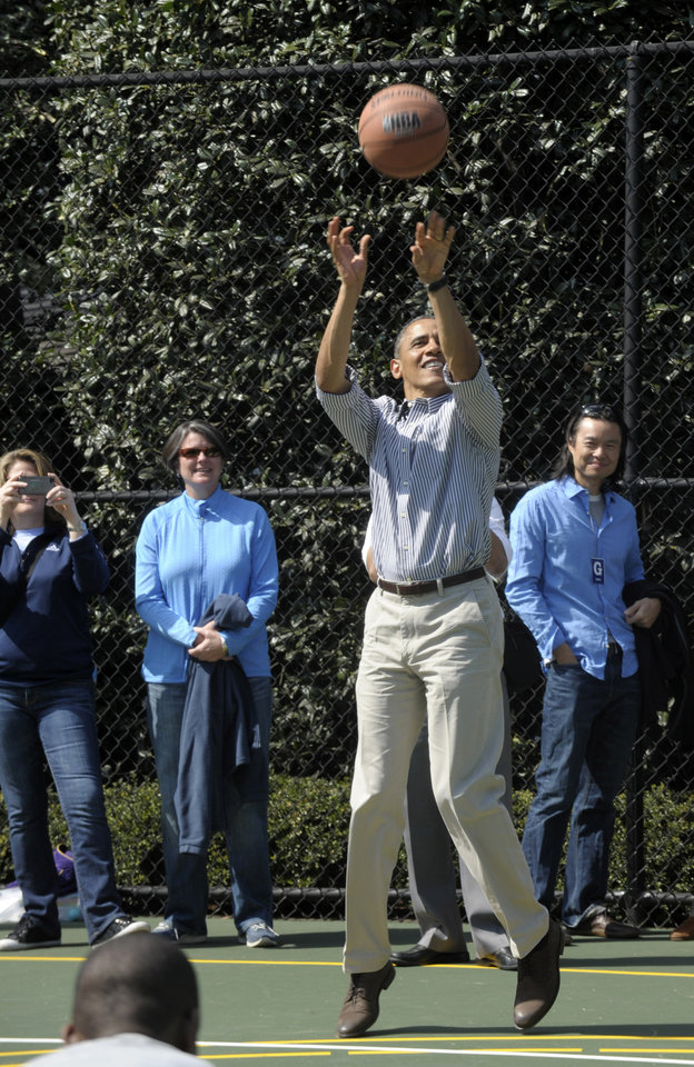 President Barack Obama shoots a basketball during the annual Easter Egg Roll on the South Lawn of the White House in Washington, Monday, April 1, 2013. (AP Photo/Susan Walsh)