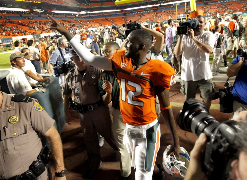 Photo - Jacory Harris of Miami celebrates after OU's 21-20 loss in the college football game between the University of Oklahoma (OU) Sooners and the University of Miami (UM) Hurricanes at Land Shark Stadium in Miami Gardens, Florida, Saturday, October 3, 2009. Photo by Bryan Terry, The Oklahoman
