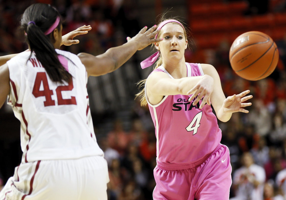Photo - Oklahoma State's Liz Donohoe (4)passes away from Oklahoma's Kaylon Williams (42) in the first half during the women's Bedlam college basketball game between the OU Sooners and the OSU Cowgirls at Gallagher-Iba Arena in Stillwater, Okla., Sunday, Feb. 16, 2014. Photo by Nate Billings, The Oklahoman