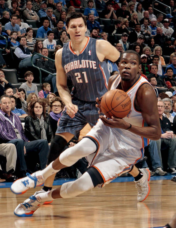 Oklahoma City Thunder's Kevin Durant (35) turns to the goal as Charlotte Bobcats' Eduardo Najera (21) watches during the NBA basketball game between the Oklahoma City Thunder and the Charlotte Bobcats at Chesapeake Energy Arena in Oklahoma City, Saturday, March 10, 2012. Photo by Steve Sisney, The Oklahoman
