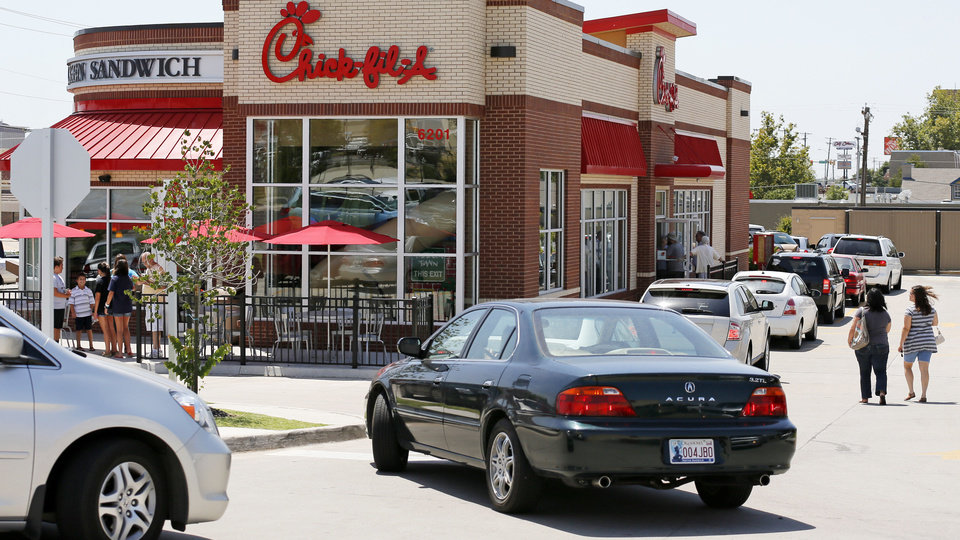 """Photo - Vehicles fill the drive-thru lane Wednesday at the Chick-fil-A at 6201 N May during """"Chick-fil-A Appreciation Day"""" in Oklahoma City. Photo by Nate Billings, The Oklahoman"""