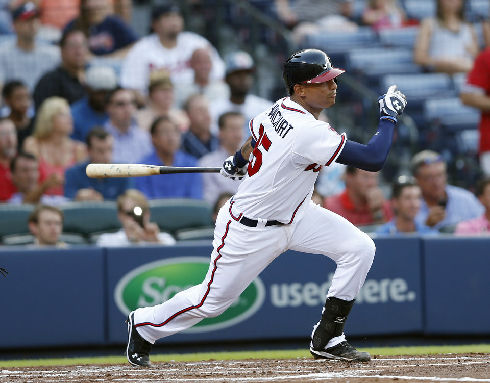 Photo - Atlanta Braves' Christian Bethancourt (25) drives in a run with a base hit in the second inning of a baseball game against the New York Mets in Atlanta, Tuesday, July 1, 2014.  (AP Photo/John Bazemore)