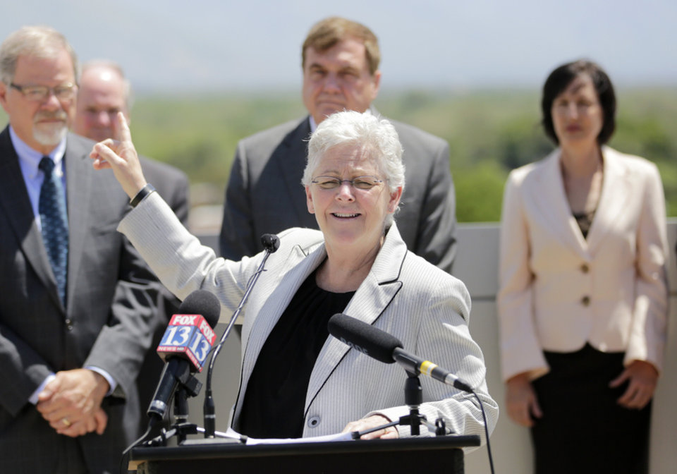 Photo - U.S. Environmental Protection Agency administrator Gina McCarthy makes remarks during a news conference Wednesday, May 21, 2014, in Salt Lake City. The head of the EPA was in Salt Lake City Tuesday to talk about the agency's efforts to reduce carbon pollution. The Utah appearance by EPA administrator McCarthy is her first stop in a three-city tour that also includes Seattle and Portland. She is meeting with politicians, local leaders and business people as the EPA tries to implement President Barack Obama's climate-change plan. (AP Photo/Rick Bowmer)