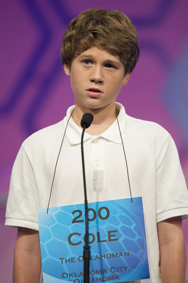 "Photo -  Cole Shafer-Ray, 14, of Norman, correctly spells the word ""samadhi"" on Thursday in the finals of the Scripps National Spelling Bee in Oxon Hill, Md. AP PHOTO   Cliff Owen -  AP"