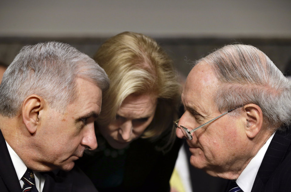 From right, Senate Armed Services Committee Chairman Carl Levin, D-Mich., Sen. Kirsten Gillibrand, D-N.Y., and Sen. Jack Reed, D-R.I., confer as Republican Chuck Hagel, a former two-term senator and President Obama's choice for defense secretary testifies before the Senate Armed Services Committee during his confirmation hearing, on Capitol Hill in Washington, Thursday, Jan. 31, 2013.  (AP Photo/J. Scott Applewhite)