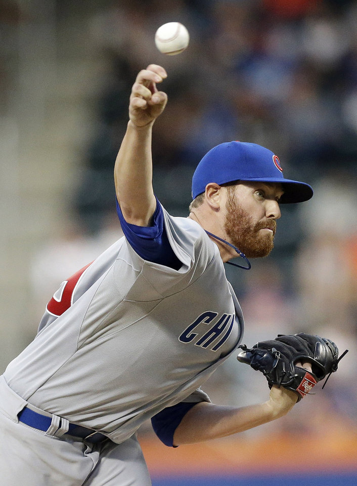Photo - Chicago Cubs' Dan Straily delivers a pitch during the first inning of a baseball game against the New York Mets, Saturday, Aug. 16, 2014, in New York. (AP Photo/Frank Franklin II)