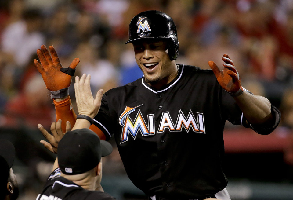 Photo - Miami Marlins' Giancarlo Stanton celebrates his home run against the Los Angeles Angels during the fourth inning of a baseball game in Anaheim, Calif., Monday, Aug. 25, 2014. (AP Photo/Chris Carlson)