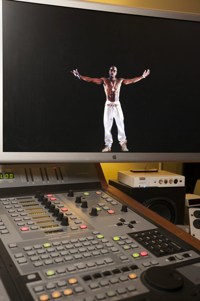 Photo -   In this photo taken Tuesday, June 12, 2012, a video image of the Tupac Shakur hologram iis displayed on a computer monitor at the Subtractive Studio in Santa Monica, Calif. When Tupac Shakur rose from the stage in the California desert earlier this year, it was not only a jaw-dropping resurrection, but also the beginning of a new form of live entertainment. Stars wield extensive control over how their names, voices and images are used after they die through likeness, trademark and copyright protections, and now holograms offer them yet another consideration. (AP Photo/Damian Dovarganes)