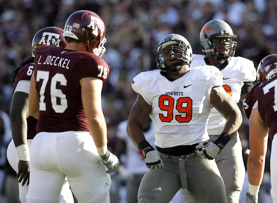 Oklahoma State's Richetti Jones celebrates a play during the Cowboys' 30-29 win over Texas A&M on Saturday in College Station, Texas. Photo by Nate Billings, The Oklahoman