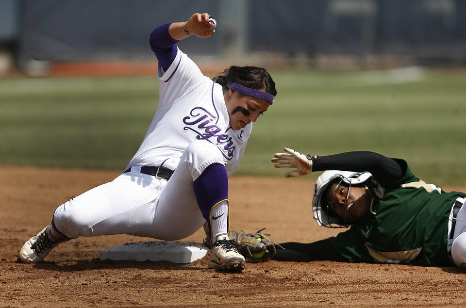 LSU\'s Julianna Santos (2) tags USF\'s Kenshyra Jackson (30) during a Women\'s College World Series game between Louisiana State University and the University of South Florida at ASA Hall of Fame Stadium in Oklahoma City, Saturday, June 2, 2012. Photo by Garett Fisbeck, The Oklahoman