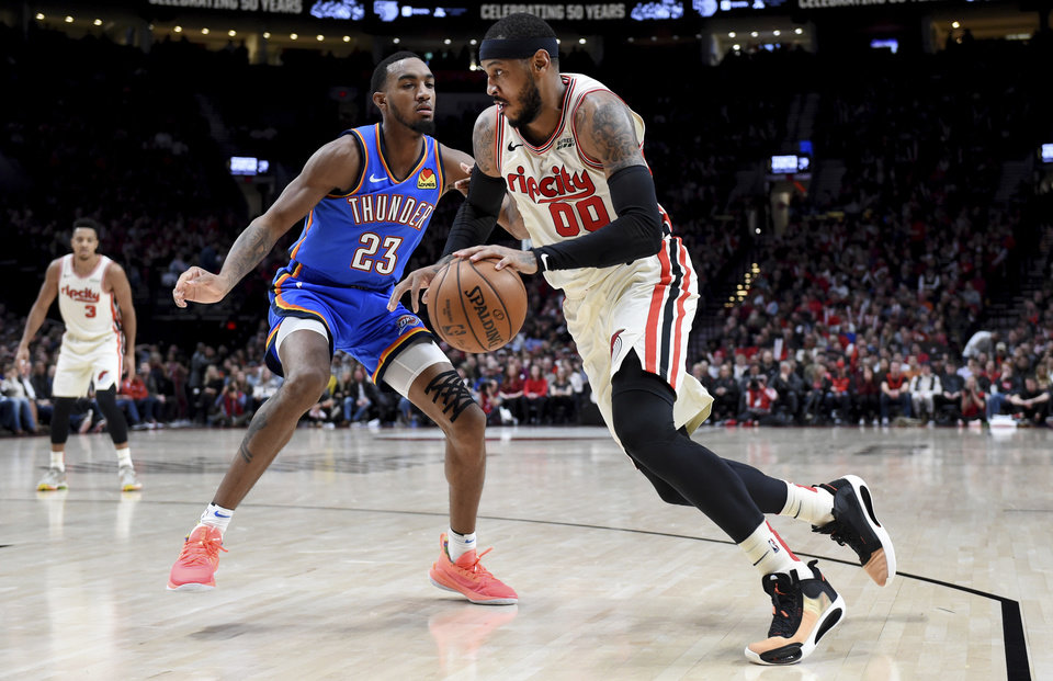 Photo - Portland Trail Blazers forward Carmelo Anthony, right, drives to the basket as Oklahoma City Thunder guard Terrance Ferguson defends during the second half of an NBA basketball game in Portland, Ore., Wednesday, Nov. 27, 2019. The Blazers won 136-119. (AP Photo/Steve Dykes)
