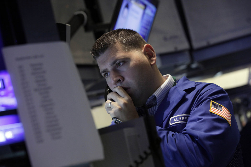 Photo -   A specialist works on the floor of the New York Stock Exchange Friday, Sept. 7, 2012. Stocks are opening mixed on Wall Street following news that the U.S. economy added fewer jobs than expected in August. (AP Photo/Richard Drew)