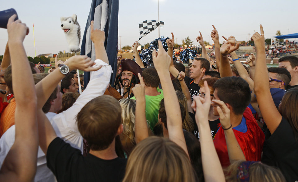 Photo - Edmond North students gather before a high school football game against Putnam City North at Wantland Stadium in Edmond, Okla., Friday, September 21, 2012. Photo by Bryan Terry, The Oklahoman