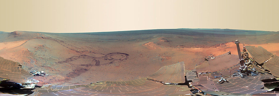 Photo - This full-circle scene combines 817 images taken by the panoramic camera (Pancam) on NASA's Mars Exploration Rover Opportunity. It shows the terrain that surrounded the rover while it was stationary for four months of work during its most recent Martian winter. Opportunity spent those months on a northward sloped outcrop,