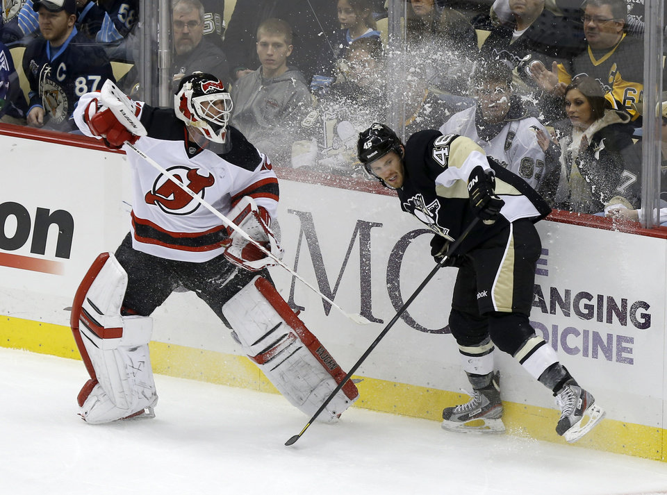 New Jersey Devils goalie Martin Brodeur, left, plays the puck past Pittsburgh Penguins' Joe Vitale (46) during the first period of an NHL hockey game, Saturday, Feb. 2, 2013, in Pittsburgh. (AP Photo/Keith Srakocic)