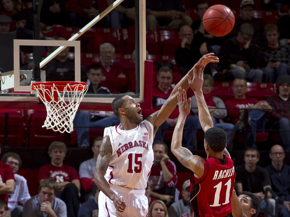 Nebraska's Ray Gallegos (15) blocks a shot by Jacksonville State's Darion Rackley (11) in the first half of an NCAA college basketball game Tuesday, Dec. 18, 2012, in Lincoln, Neb. (AP Photo/The Omaha World-Herald, Mark Davis)  MAGS OUT  LOCAL TV OUT